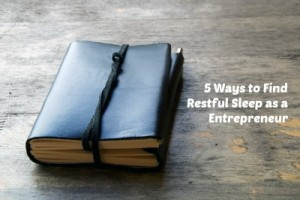 5 Ways to Find Restful Sleep as a Entrepreneur, A leather bound journal sits on a table outside with a cord wrapped around the pages to keep place in book.