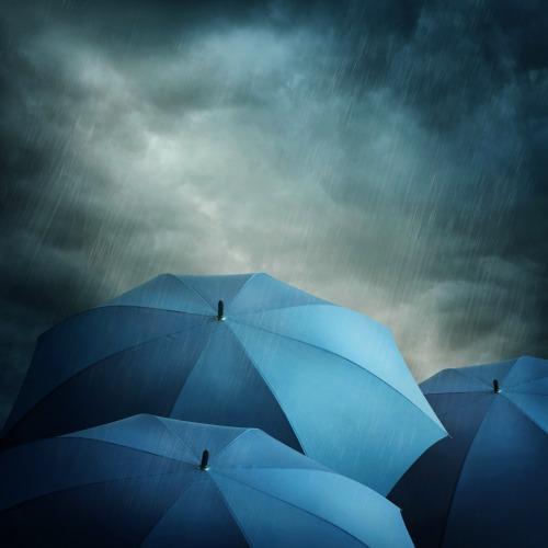 Hurricane Irma stormy weather ahead, Dark stormy clouds and umbrellas
